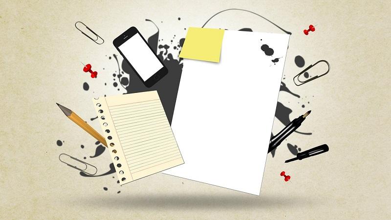 書類、インク、鉛筆、スマートフォン